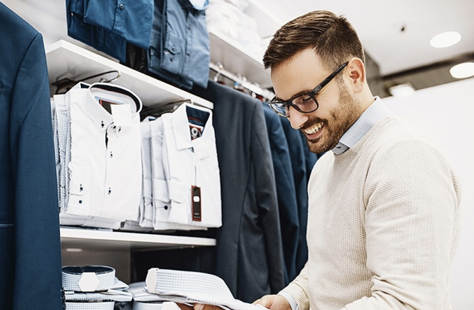 Man shopping in retail store, representing cash purchases secured by Tidel Smart Safes.