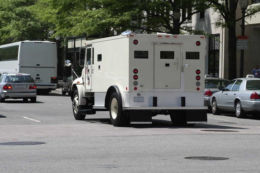 Image of Armored Truck Representing Reduced CIT Fees