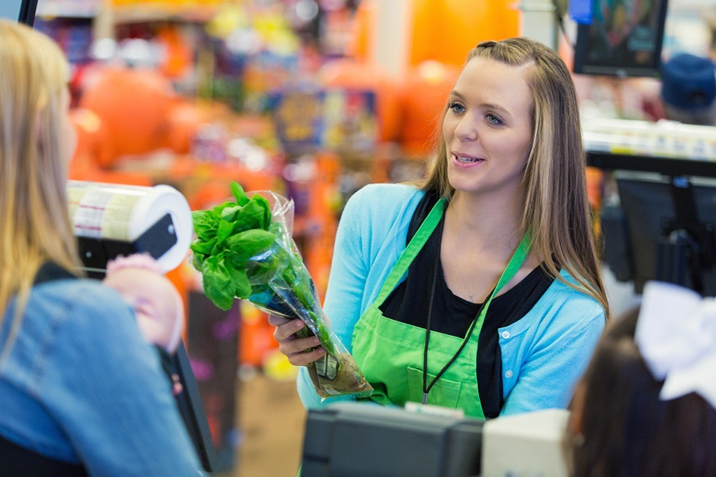Image of Store Clerk Representing Optimized Usage of Labor